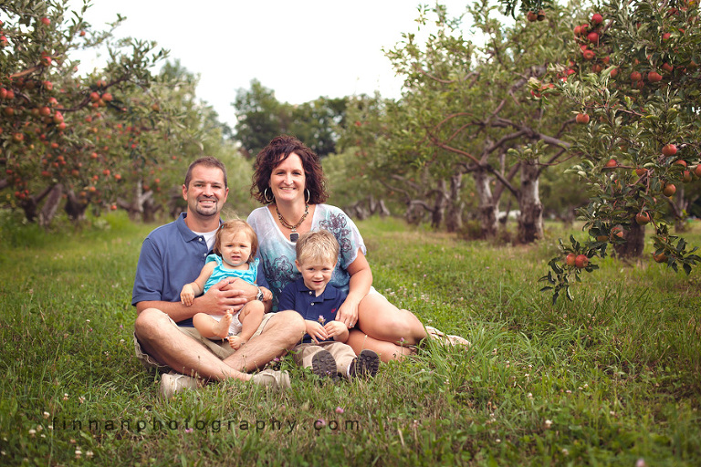 family sitting at apple hill orchard in mansfield, ohio