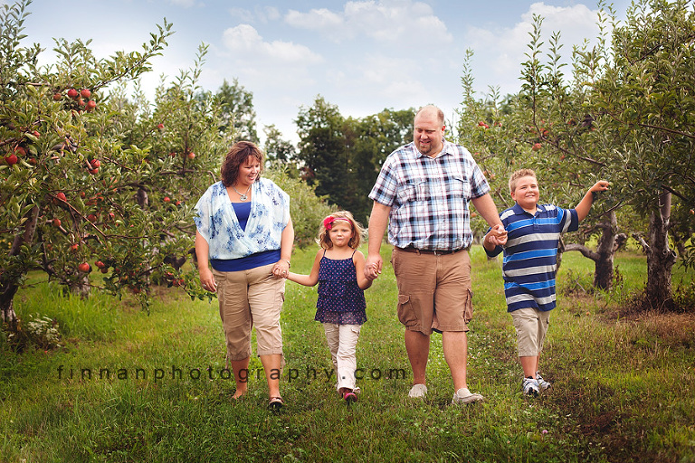 family walking at apple hill orchard
