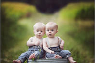 twin 6 month old boys on farm